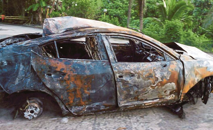 Woman burns to death in Sandakan car crash | New Straits