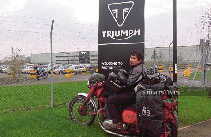 Mohd Shahrul Zaim Jamil, better known as Ali Klasik Garero, on his Triumph motorcycle outside the Triumph factory in Hinckley, England. -- Pix: ZAHARAH OTHMAN