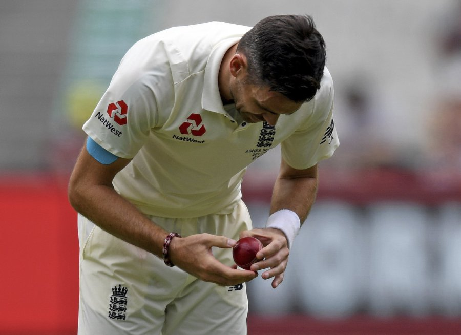 James Anderson of England inspects the ball on Day Four of the Boxing Day test match between Australia and England at the Melbourne Cricket Ground (MCG) in Melbourne, Victoria. EPA-EFE