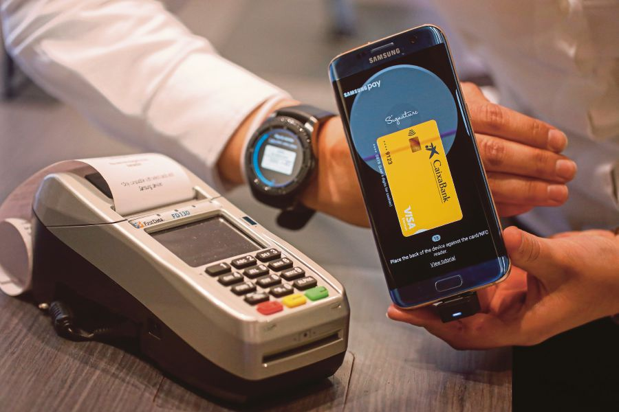 5pc of stancharts credit card clients will adopt samsung pay new standard chartered bank malaysia says samsung pay is a very safe method of conducting transactions bloomberg pic reheart Gallery
