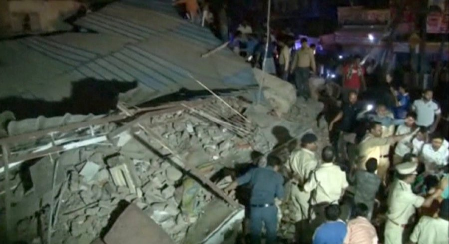 Image result for Ten killed after a four-storey building collapses in Indian city