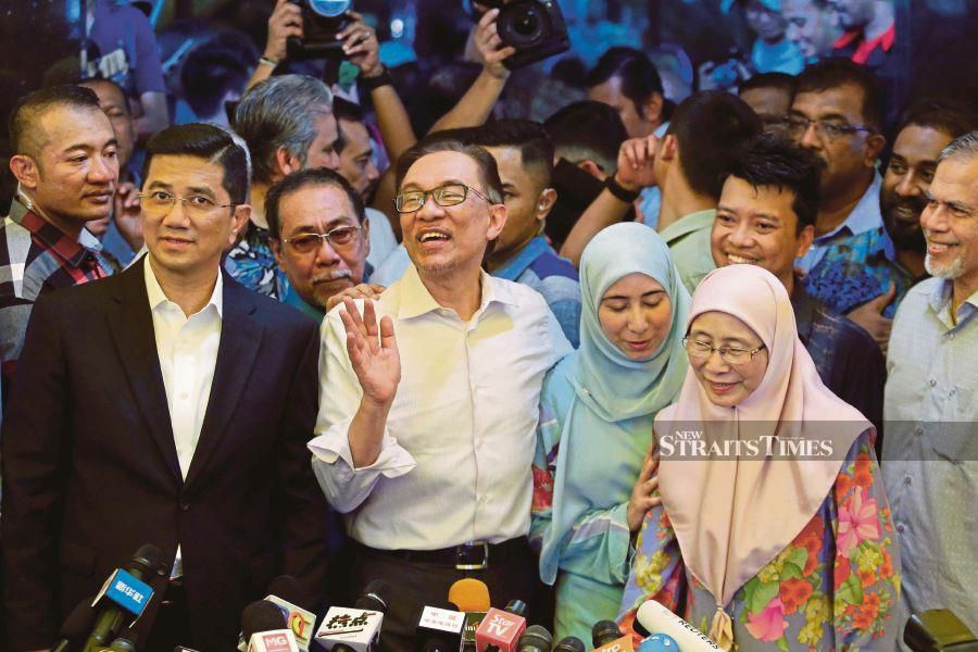 PKR president Datuk Seri Anwar Ibrahim with Datuk Seri Azmin Ali after the former was given a royal pardon in May last year. FILE PIC