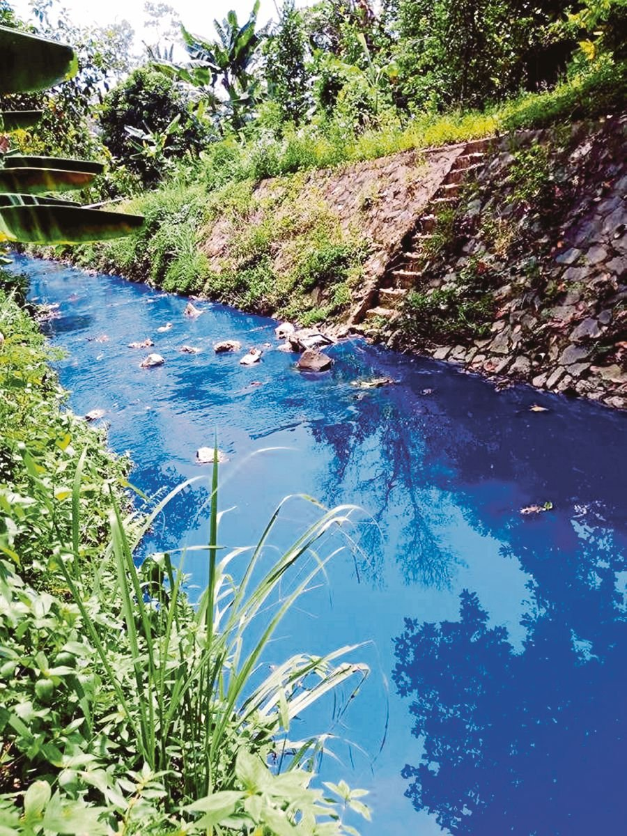 (File pix) Pollution from a factory in Senawang Light Industrial Park, Senawang, Negri Sembilan, turned Sungai Simin blue last month. Government policies can play an important role in protecting the environment.