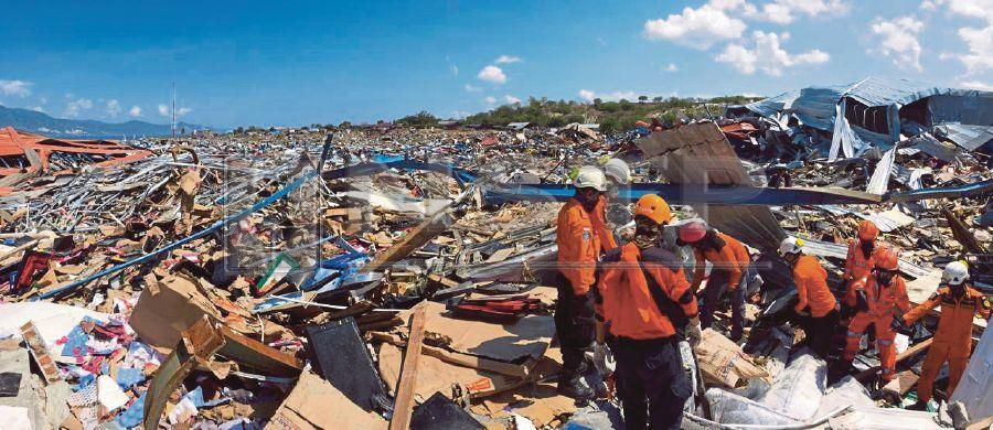 Rescuers searching for victims in Palu, Sulawesi, yesterday. EPA PIC