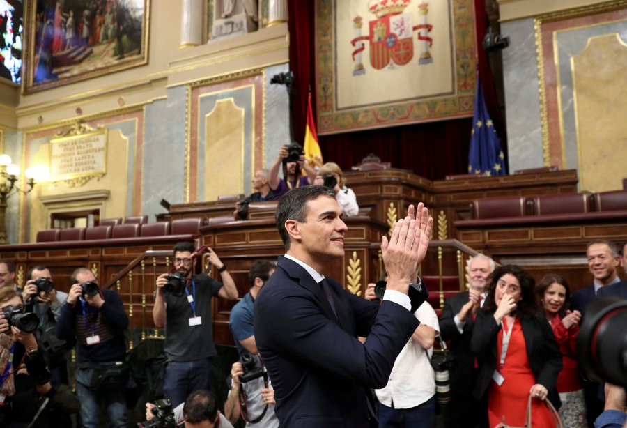 Spain's new Prime Minister and Socialist party (PSOE) leader Pedro Sanchez applauds after a motion of no confidence vote at parliament in Madrid, Spain. REUTERS