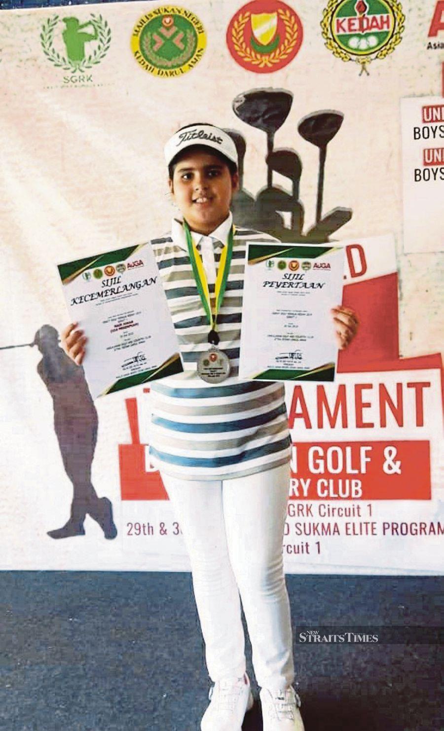 Young golfer Mehekpreet Kaur Randhawa says her parents, grandfather and Tiger Woods are her inspiration.