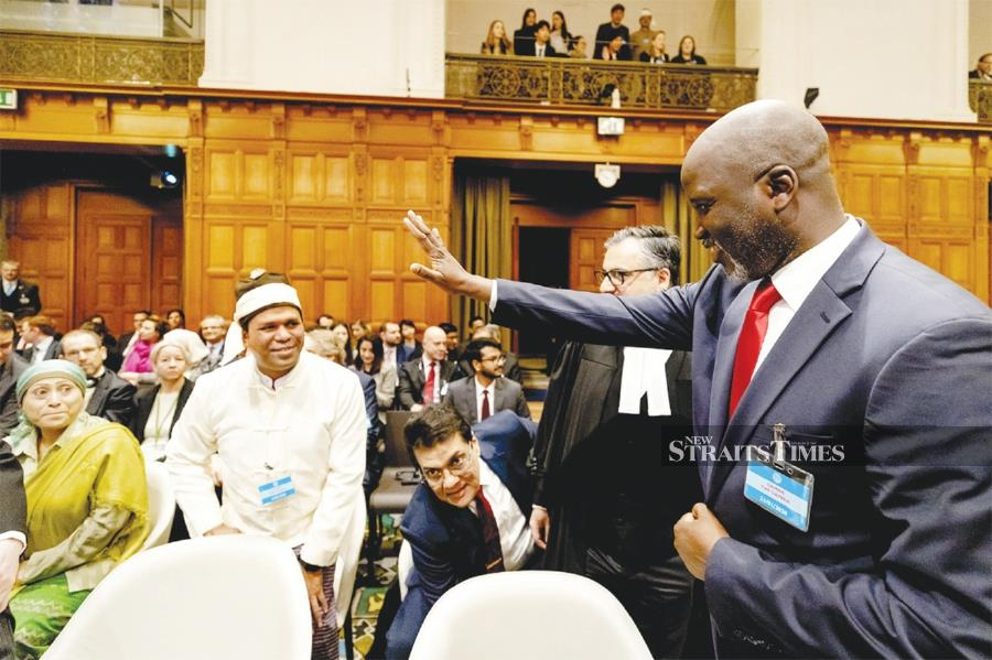 Abubacarr Tambadou waving to a representative of the Rohingya community at the International Court of Justice in The Hague, Netherlands recently. Men of courage are needed in trying times. AFP PIC