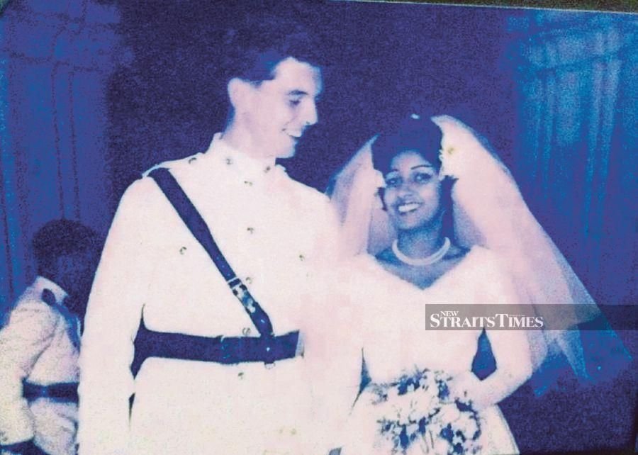 Christopher James Syer (left) and Malayan Airways Ltd flight stewardess Amarjit 'Ambi' Kaur at their wedding in St Andrew's Cathedral, Singapore, on Sept 23, 1961.