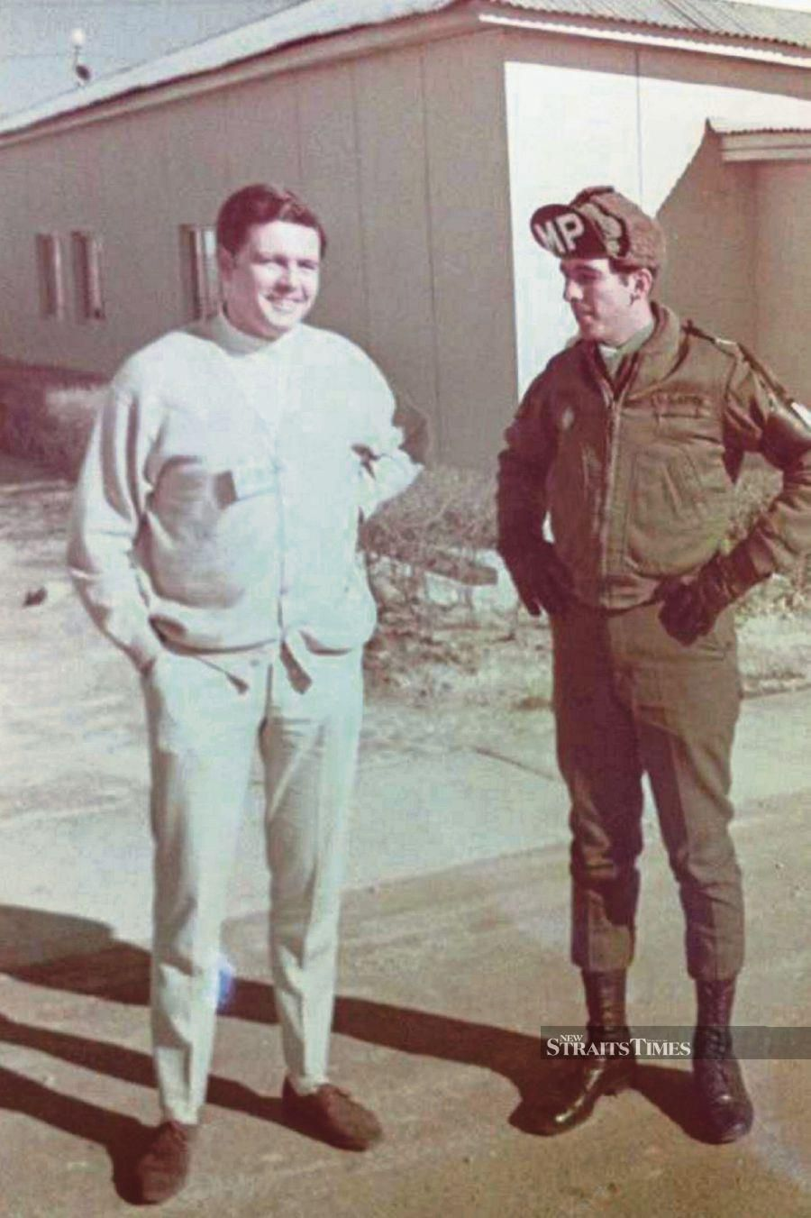 Christopher James Syer (left) and his friend during a visit to the Korean demilitarised zone in Panmunjom, North Korea, in November 1970.