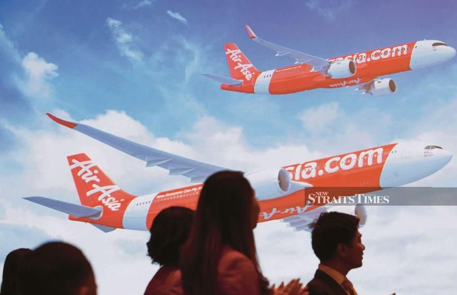 AirAsia Group CEO Tan Sri Tony Fernandes and chairman Datuk Kamarudin Meranun have stepped aside from their executive roles for at least two months, even as the authorities investigate allegations that Airbus paid a bribe of US$50 million to win plane orders from the company. - NSTP file pic