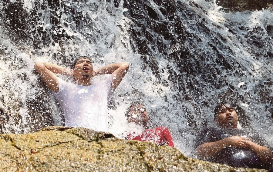 File picture showing people at a waterfall in Templer Park, Rawang. The United Nations 2030 Sustainable Development Agenda espouses the belief that no one should be left behind in enjoying health and well-being, quality education and clean water.