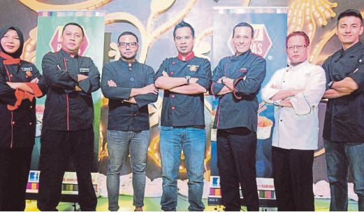 Kamarul with the guest chefs who will be featured in the new season of Baba's Cu-bits. (From left) Chef Zainab, Chef Kamaruzzaman, Chef Adu Amran, Chef Kamarul, Chef Joaquim Miguel, Chef Zulkifli and Chef Billy.