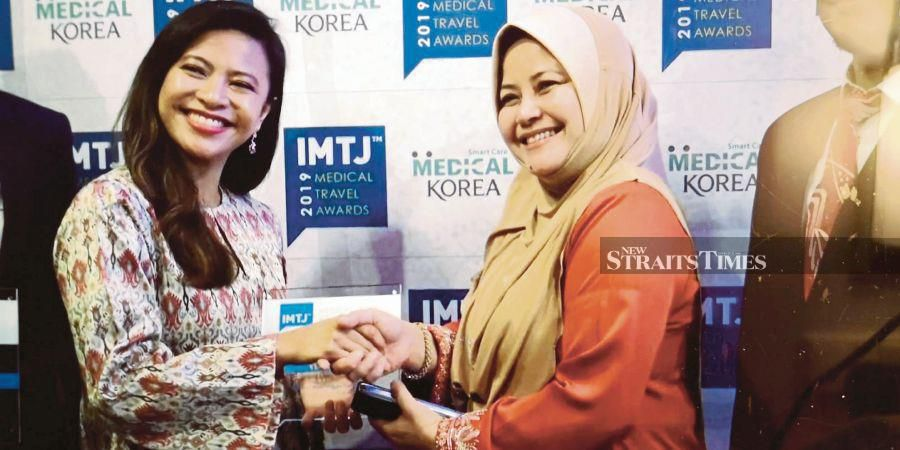Malaysia Healthcare Travel Council chief executive officer Sherene Azli (right) and Thomson Hospital CEO Nadiah Wan at the International Medical Travel Journal Awards 2019 in Berlin, Germany, on Tuesday.