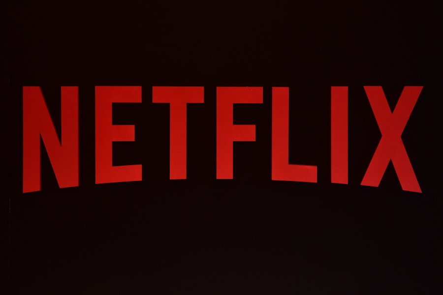 (FILES) This file photo taken on March 1, 2017 shows the Netflix logo during a Netflix event in Berlin. Netflix will spend Can500 million (US400 million) over the next five years to make original films and television shows in Canada, the company and Heritage Minister Melanie Joly announced on Sept 28, 2017. Netflix on Oct 5, 2017 said it is bumping up subscription prices in the US and parts of Europe as the leading online streaming service invests in more shows and features.(AFP PHOTO)