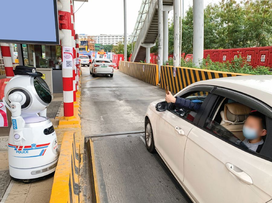 Robots like this serve several hours a day at intersections in Shenzhen, China, to remind passing motorists to register passengers' information via QR code on the robot, as well as take people's temperature. PIC COURTESY OF UBTECH ROBOTICS
