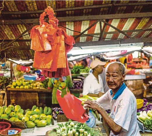 A candid shot of a vegetable seller at Chow Kit market in KL.
