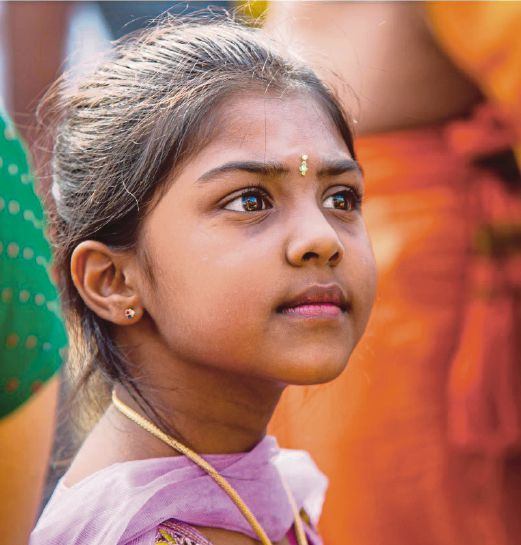 A girl joining in the Thaipusam celebration at Batu Caves.