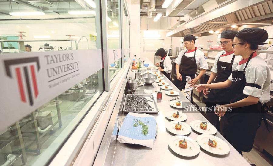 Taylor's Advanced Diploma in Patisserie and Gastronomic Cuisine students preparing the amuse bouche to be served to the guests. -NSTP/Mohamad Shahril Badri Saali