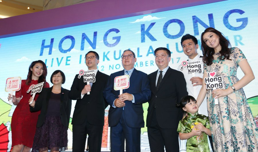 Hong Kong Special Region Government secretary justice Rimsky Yuen (third from left), Hong Kong Tourism Board chairman Peter Lam (fourth from left), Hong Kong Tourism Board executive director Anthony Lau (centre) and local celebrities Awal Ashaari (second from right), Lara Alana (third from right) and Scha Alyahya (right) at the launch of Hong Kong Live in Kuala Lumpur. NST photo by ROSELA ISMAIL