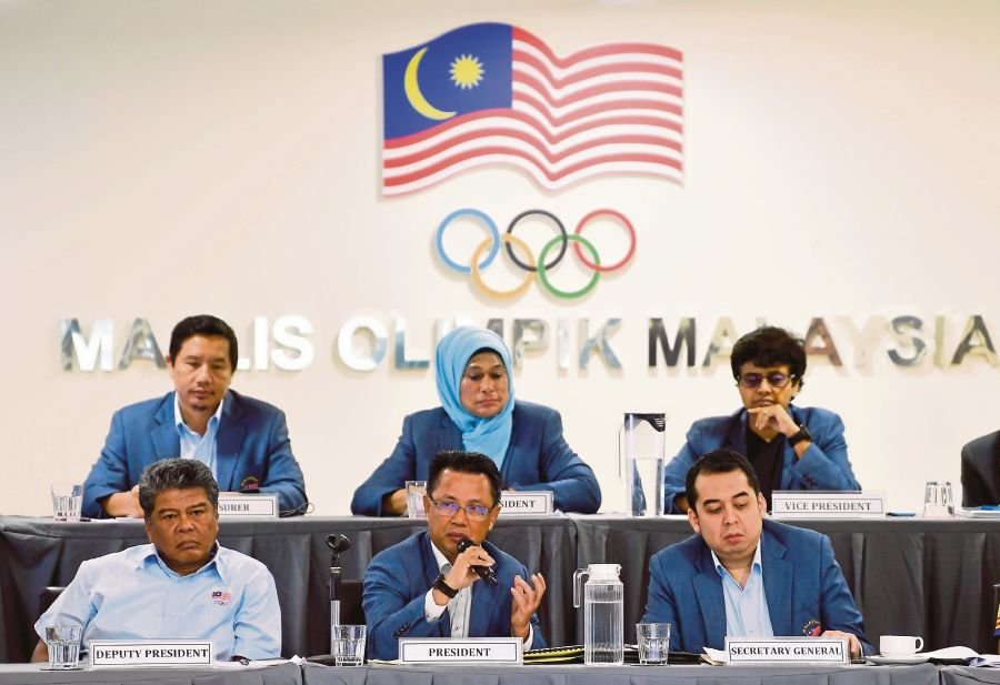 Olympic Council of Malaysia (OCM) President Datuk Seri Mohamad Norza Zakaria (middle) with deputy president Datuk Seri Azim Zabidi (left) and secretary general Datuk Mohd Nafizuddin Mohd Najib (right) during the 192nd OCM Executive Council Meeting at OCM Indoor Sports Complex on March 7. - BERNAMA pic
