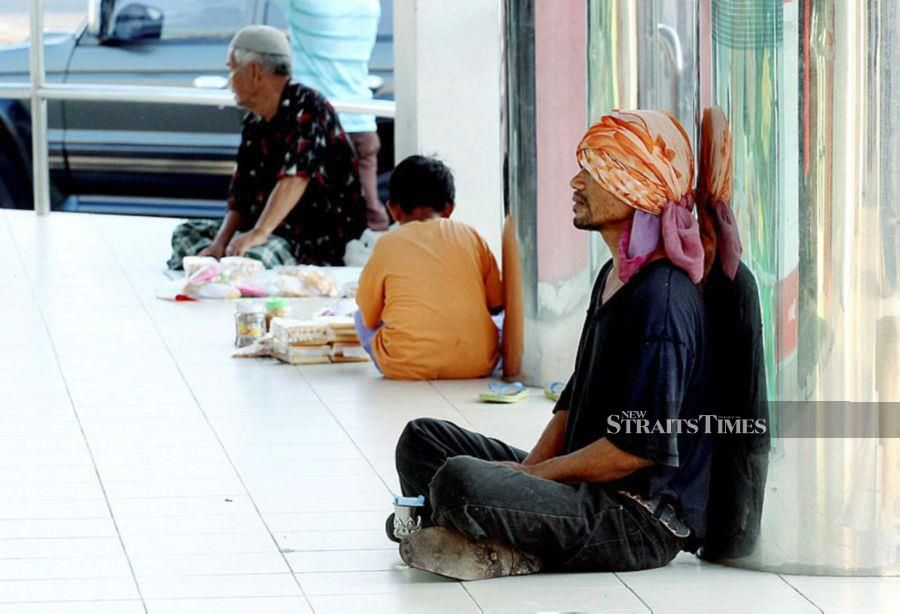 (File pix) Beggars and vagrants are a daily sight.