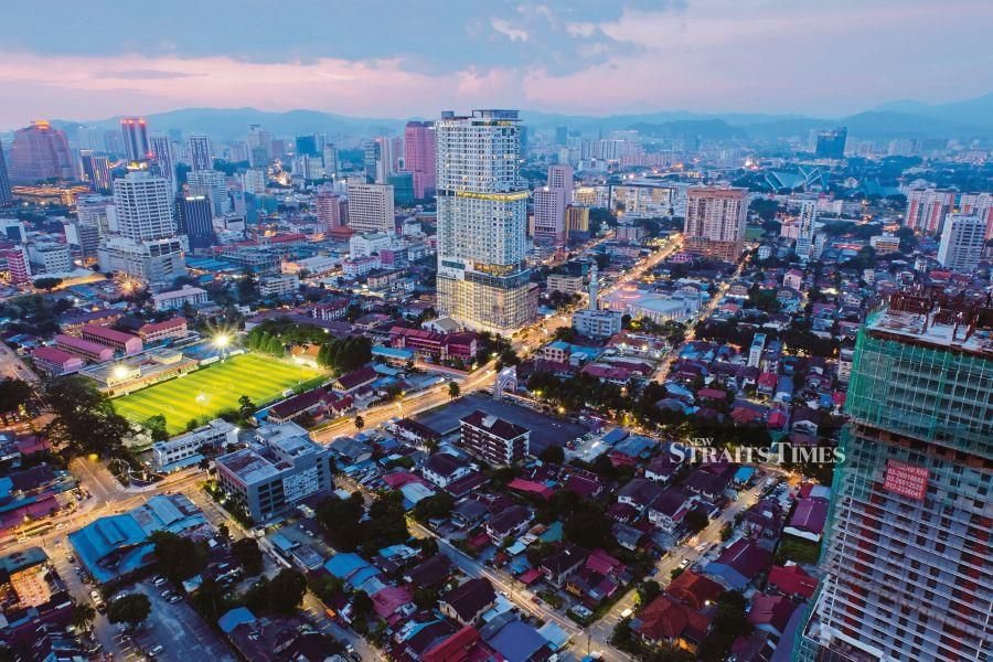 Kg Baru at dusk. The under-construction building at the bottom right was where the writer used to live. PIC BY IZWAN ISMAIL