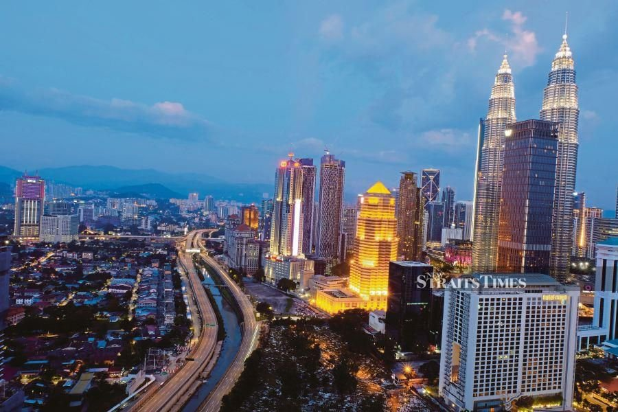 Kg Baru (left) and Kuala Lumpur city centre are separated by the AKLEH highway and Sungai Klang. PIC BY IZWAN ISMAIL