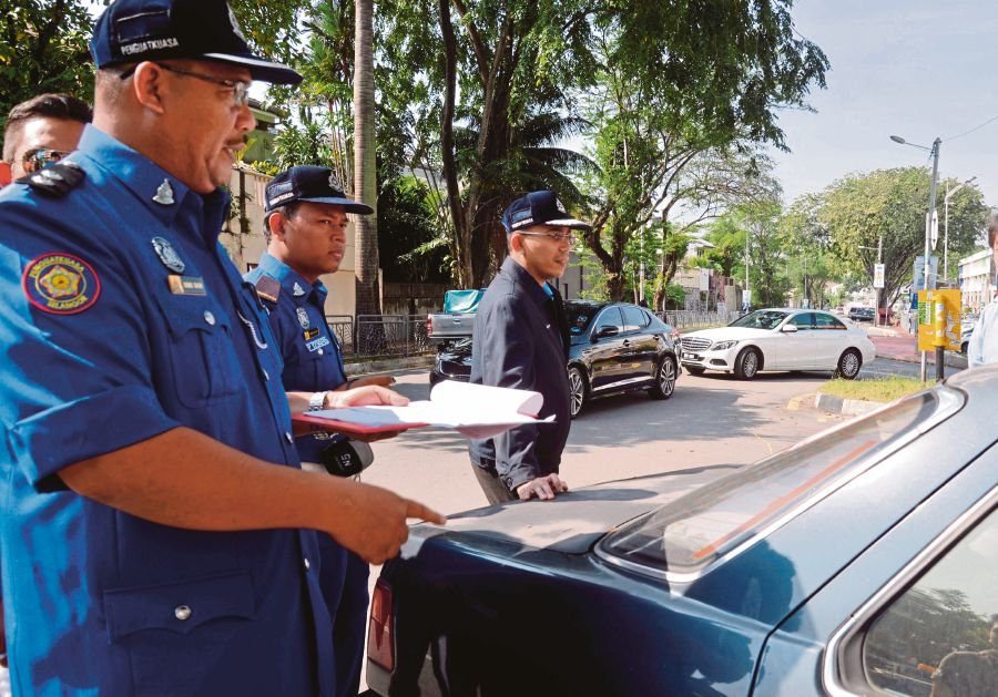 Confounded by parking coupon system | New Straits Times