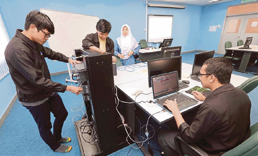 German Malaysia Institute students installing cables at the Cybersecurity lab. -NSTP/Saifullizan Tamadi.