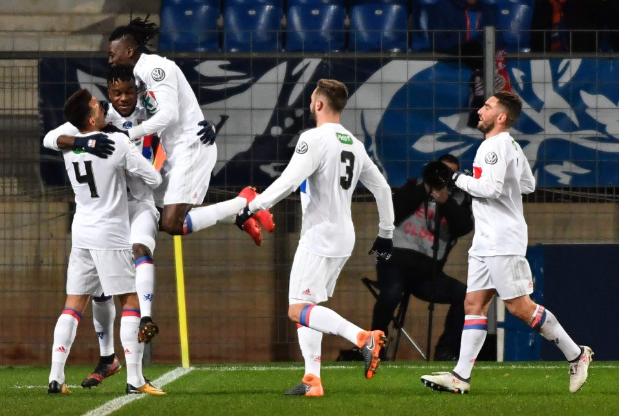 Lyon's Maxwel Cornet (2nd left) celebrates with his teammates after scoring a goal. AFP