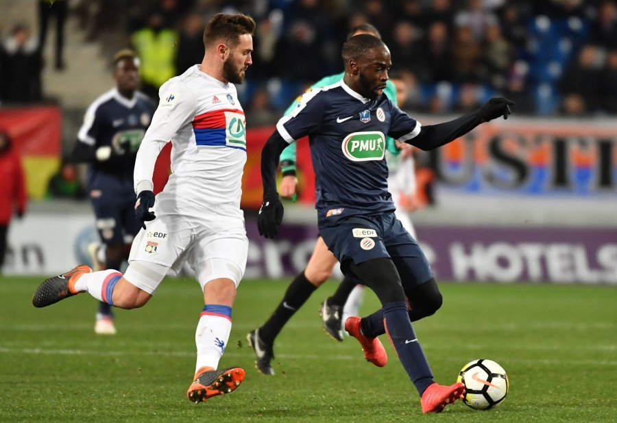 Montpellier's Jonathan Ikone (right) dribbes past Lyon's Lucas Tousart. AFP
