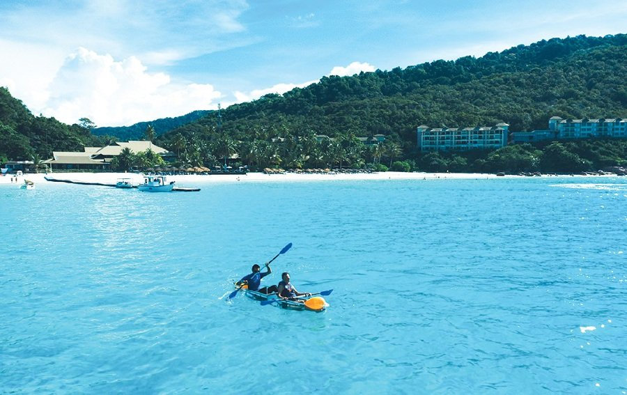 Guests can snorkel and kayak on the clear waters off the island.