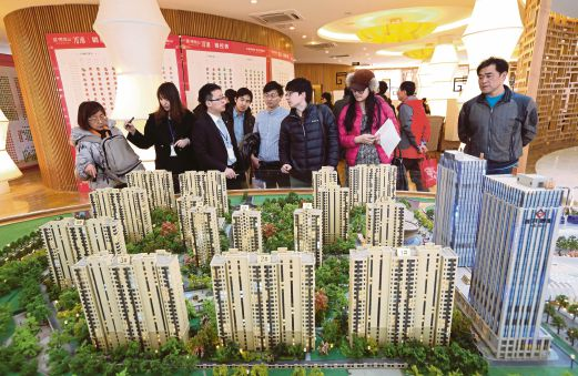 Analysts say China's growth outlook is weighed down by trouble in the property sector — where new home prices posted its fourth consecutive decline in August. Bloomberg pic