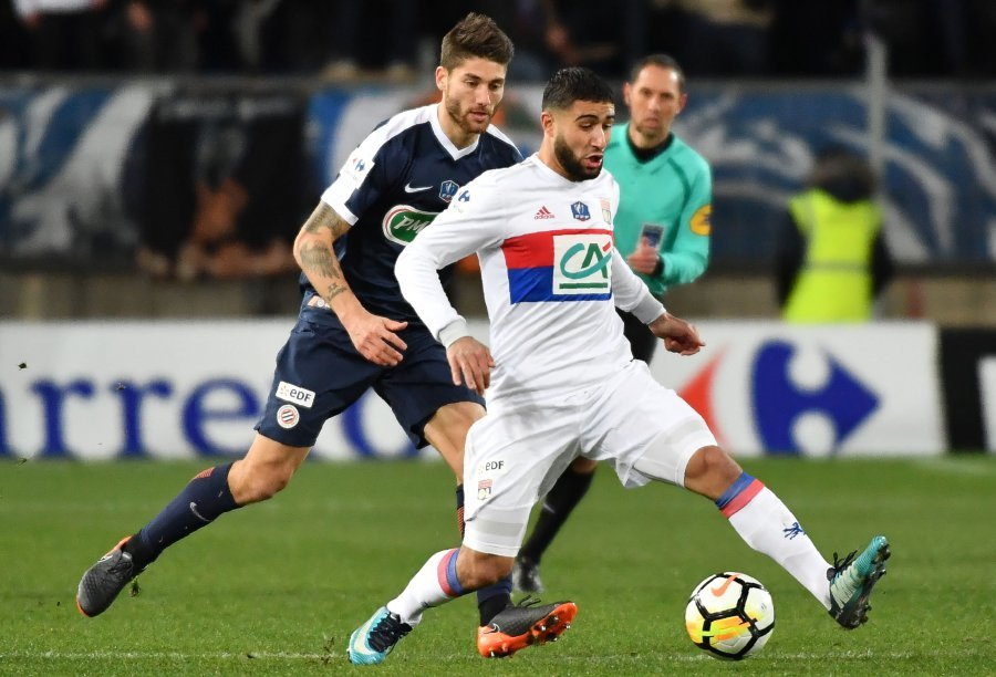 Montpellier's Paul Lasne (left) vies with Lyon's Nabil Fekir during the French Cup match at the La Mosson stadium in Montpellier. AFP