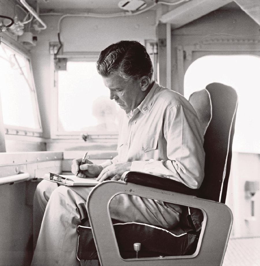 Captain Guy Richmond Griffiths working diligently on the 'Captain's Seat' on the bridge of HMAS 'Hobart' in 1967. PIC COURTESY OF REAR-ADMIRAL (RTD) GUY RICHMOND GRIFFITHS