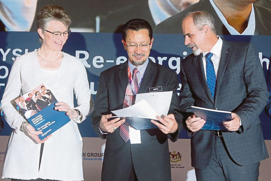 Economics Affairs Ministry secretary-general Datuk Saiful Anuar Lebai Hussen (centre), World Bank Country Director for Brunei, Malaysia, the Philippines and Thailand, Mara Warwick (left) and United Nations Resident Coordinator (Malaysia) Stefan Priesner at the launch of the 12th Malaysia Plan (2021-2025) Kick-Off Conference and 20th 'Malaysia Economic Monitor'. FILE PIC