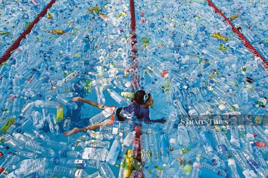 A child swimming in a pool filled with plastic bottles during an awareness campaign to mark World Oceans Day in Bangkok on Saturday. World Oceans Day is a global celebration on June 8 with hundreds of events around the world celebrating our oceans. AFP PIC
