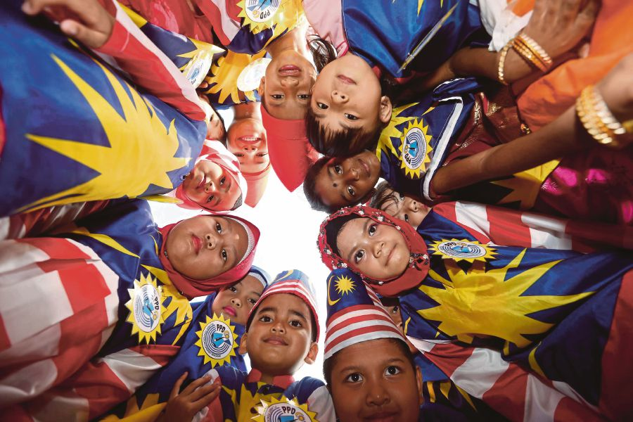 Children celebrating National Day in Tangkak, Johor, last year. Vision with action can change the nation for the better.