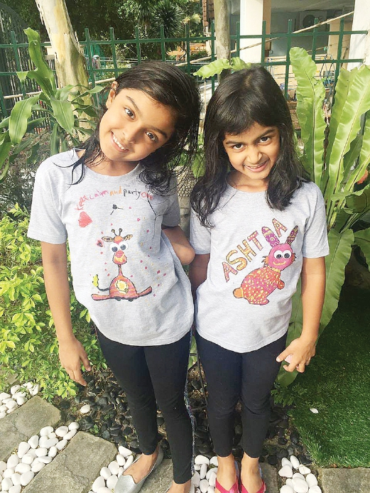 Wear with pride — kids showing off their creations.