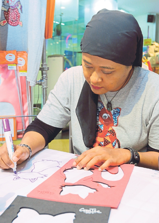 Masliza says CreaTee is determined to fight for a good cause through simple art