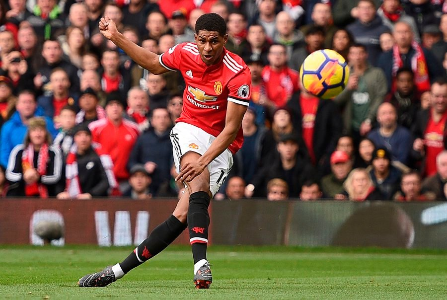 46c3261ce Manchester United s English striker Marcus Rashford scores the opening goal  during the English Premier League football match between Manchester United  and ...