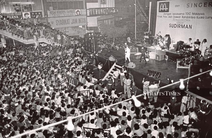 Some of the 100,000 people who thronged the free mega concert by Datuk Sudirman Arshad in Chow Kit Road on April 14, 1986. FILE PIC
