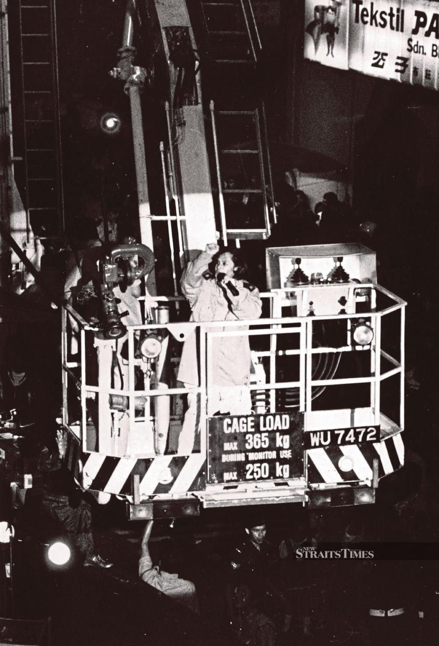 Datuk Sudirman Arshad made a typically spectacular entrance onto the stage from a fire engine's Simon Snorkel skylift during his famous concert in Chow Kit Road. FILE PIC