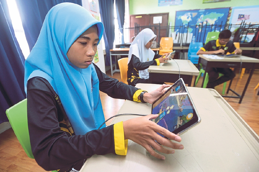 Choices in the new curriculum allow students to explore careers like coding and programming. -NSTP/Saddam Yusoff.