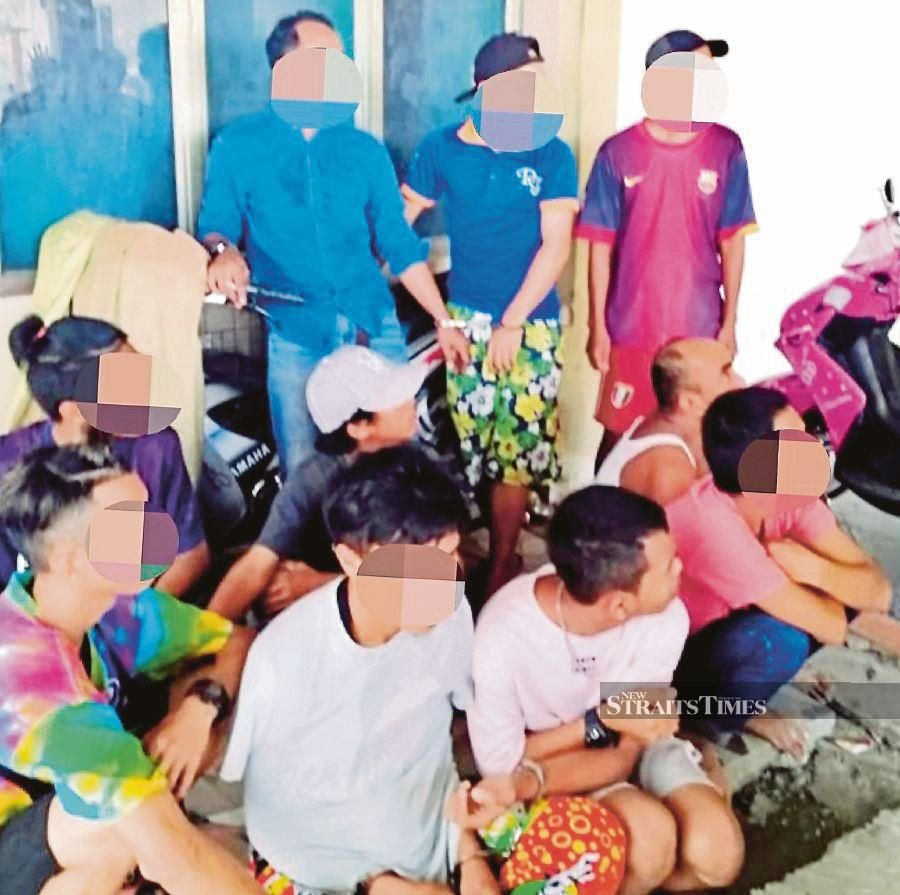 Drug users rounded up by police and anti-narcotic officers in Kota Kinabalu earlier this year. FILE PIC