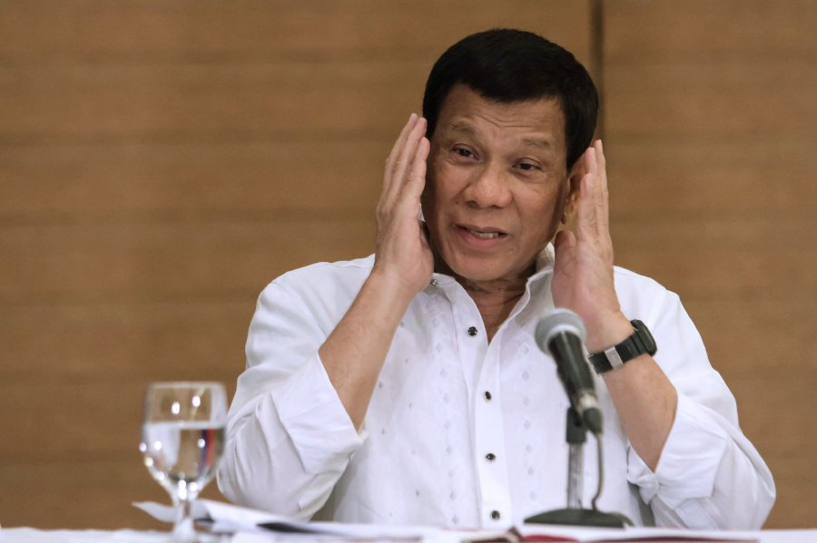 Duterte tells Philippine soldiers to shoot female rebels in their vaginas
