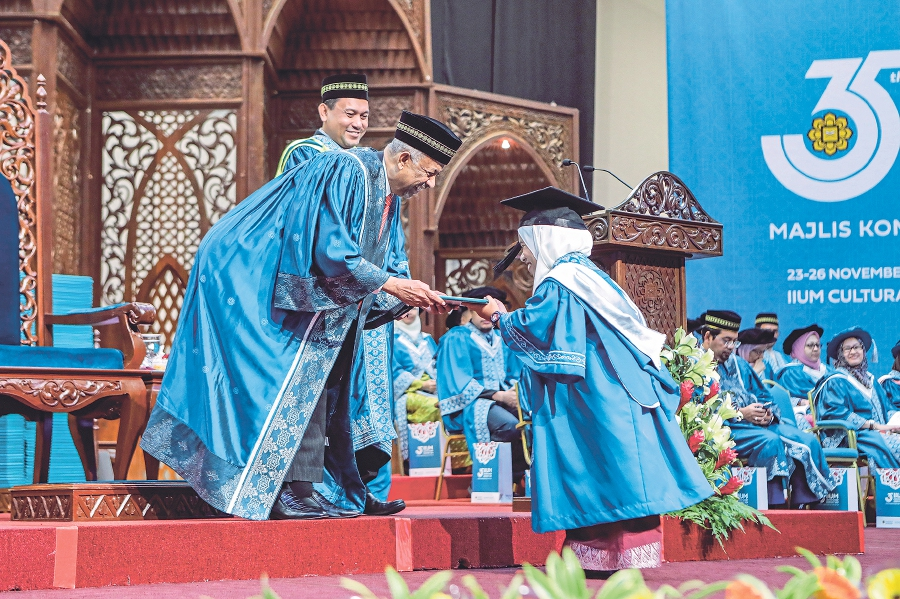 A disabled graduate receiving her scroll at the 35th International Islamic University Malaysia convocation last year. -NSTP/Aizuddin Saad