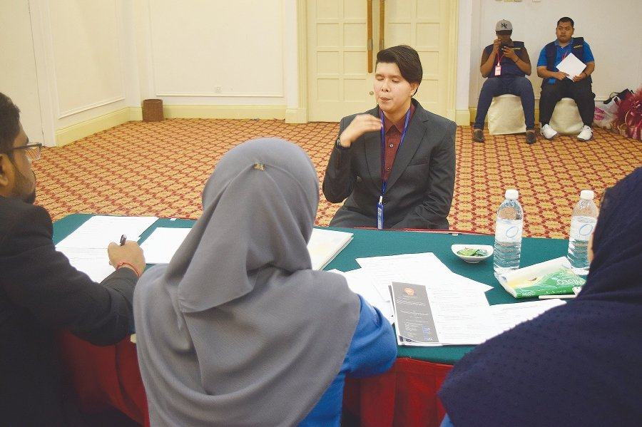 A blind student undergoing a mock interview at a Universiti Malaya Visually Impaired Career Workshop.