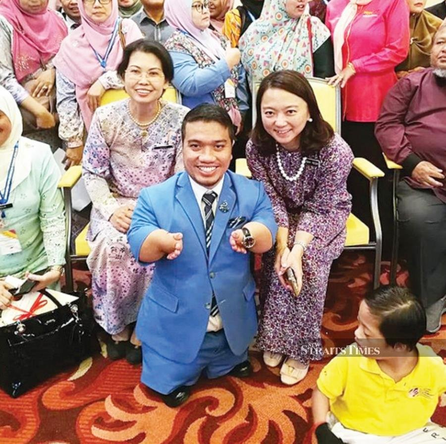 Deputy Women, Family and Community Development Minister Hannah Yeoh (sitting right) with Mohd Sukur Ibrahim (centre) at the closing of the Community Rehabilitation Convention 2019 in Melaka last year. Also seated is Datuk Maria Bernard Sinsoi (left), director of the Department of the Development of Persons with Disabilities.