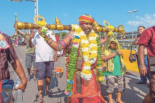 A devotee carrying a kavadi.
